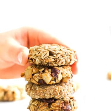 Child Grabbing Banana Oatmeal Cookie from Stack