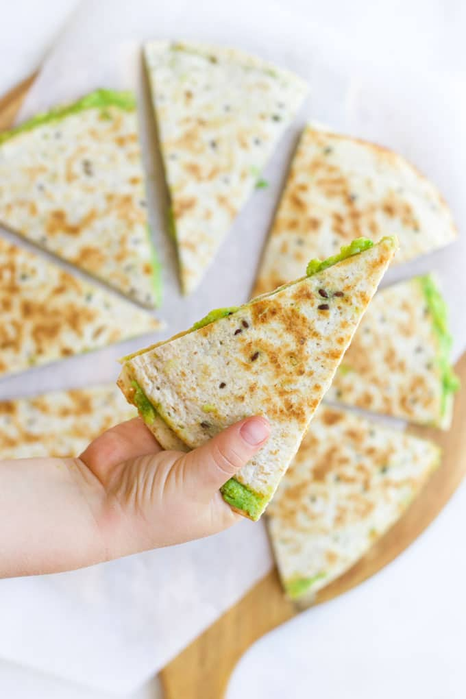 Child Grabbing an Avocado Quesadilla from Board