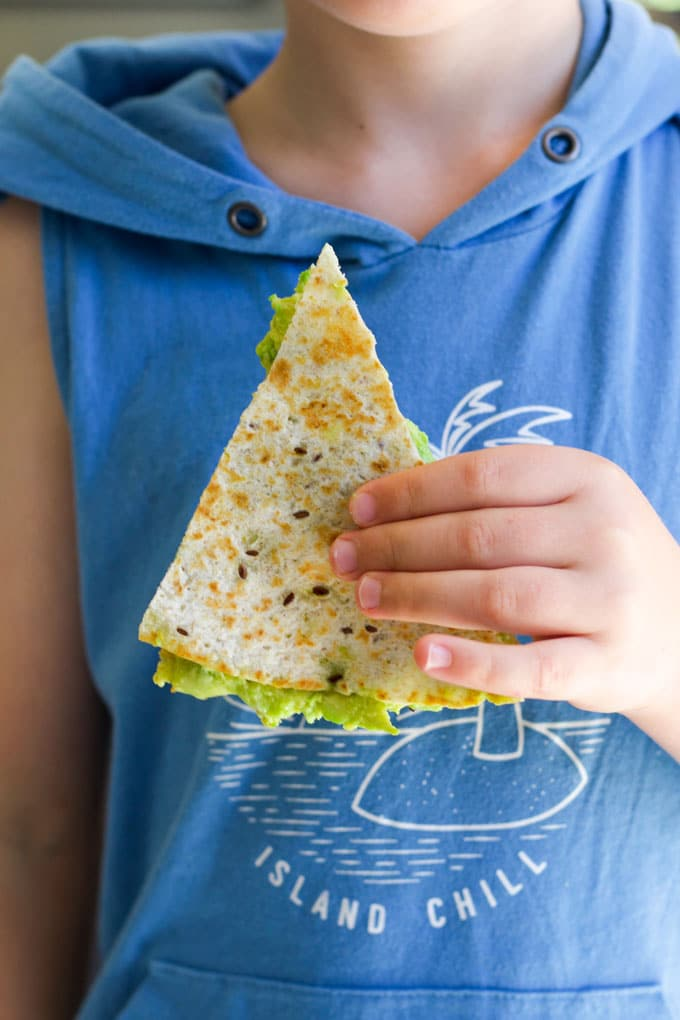 Child Holding Avocado Quesadilla