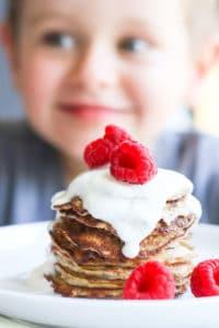 Child Looking at a Stack of Banana Pancakes