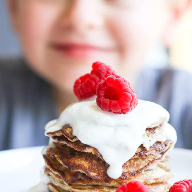 Child Looking at a Stack of Banana Pancakes