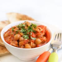 Chicken Chickpea Stew Served in Bowl with Pita Bread