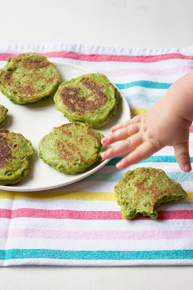 pea fritters baby grabbing it