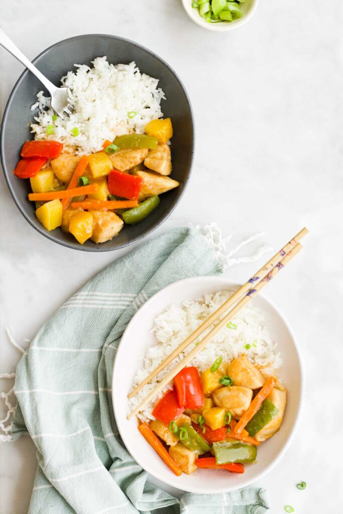 Flat Lay Shot of Two Bowls of Sweet and Sour Chicken and Rice