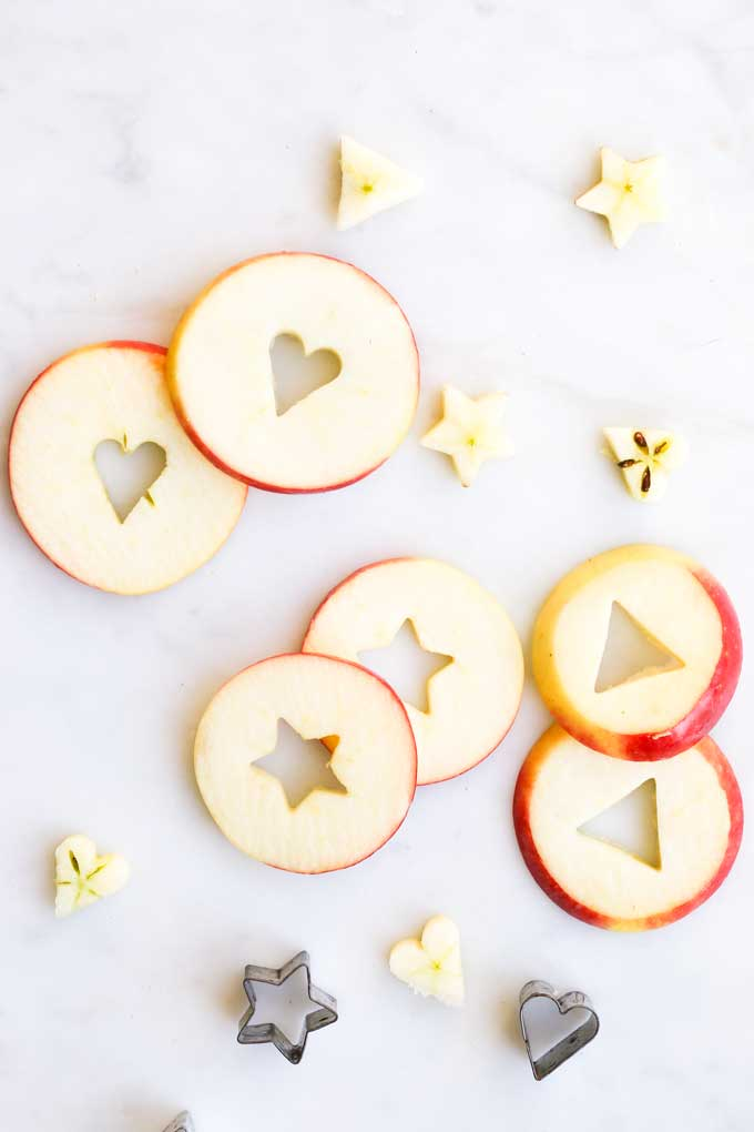 Apple Slices with Centres Cut Out Using Cookie Cutters