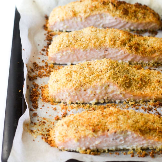 Freshly cooked parmesan crusted salmon fillets on baking tray