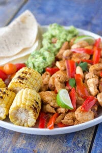 chicken fajitas are a fun and interactive meal for kids. Serve with a range of veggies, dips and sauces and let your kids build their own.