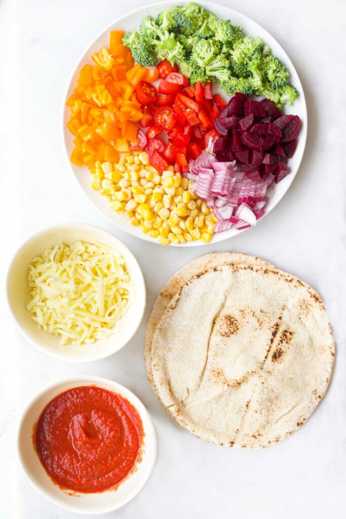 Top Down View of Ingredients to Make Rainbow Pitta Pizzas