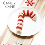 Healthy candy cane made from strawberry and banana. A healthy Christmas snack for kids.