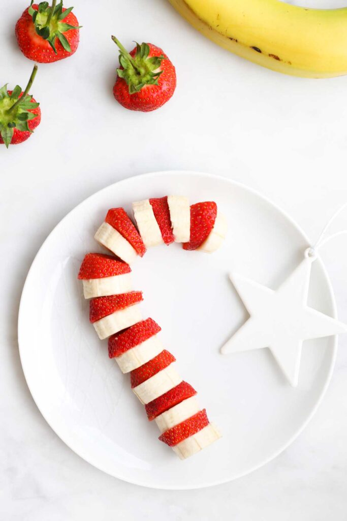 Banana and Strawberry Slices Arranged on Plate to Look Like Candy Cane