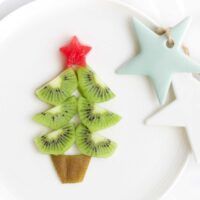 Christmas Tree Made from Kiwi Slices on Plate with Watermelon Star