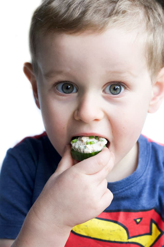 Child Eating Healthy Tuna Salad on Cucumber