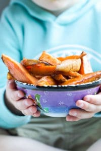 Child Holding Bowl of Sweet Potato Wedges