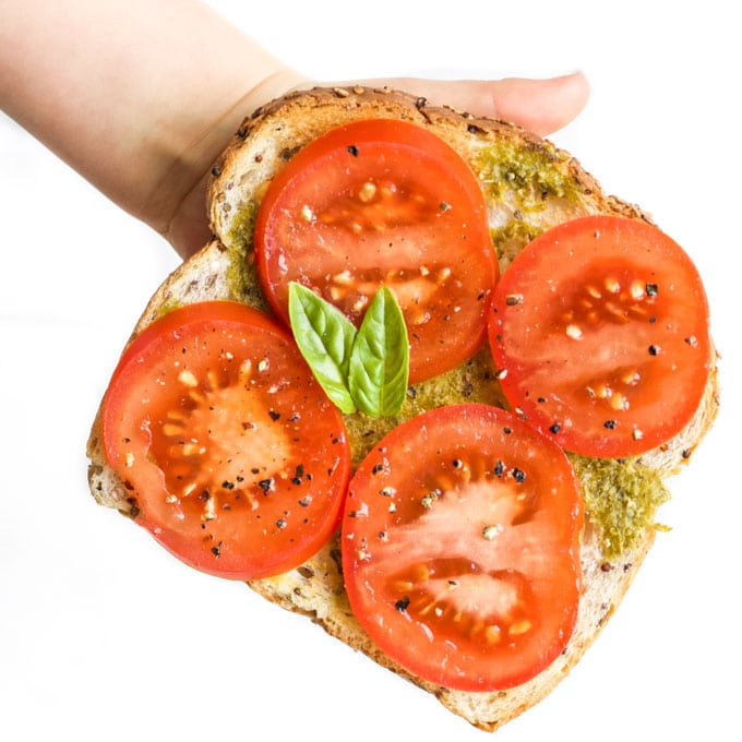 Toast Spread with Pesto and Topped with Slices of Tomato