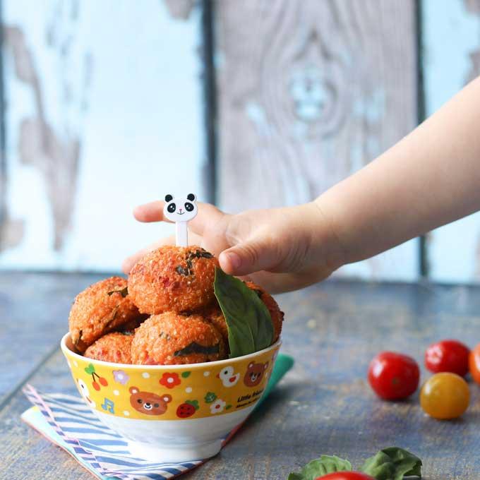 Child Grabbing Quinoa Ball from Bowl