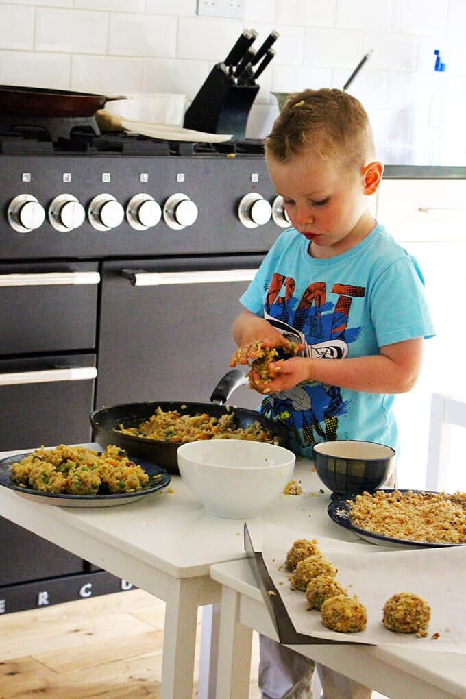 Child making risotto balls