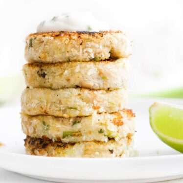 Side on View of Stack of 5 Tuna Fish Cakes Topped with Yogurt Dip