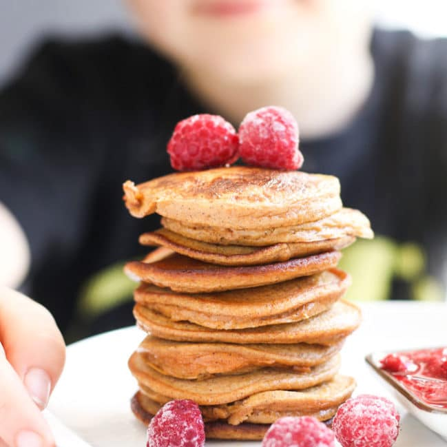Child Looking at a Stack of 2 Ingredient Sweet Potato Pancakes