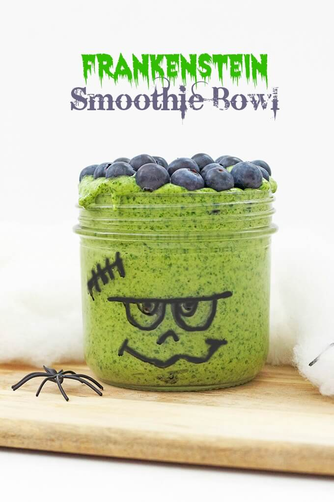 Frankenstein Smoothie Bowl (healthier halloween snacks for kids) Spinach, banana and mango blended together and topped with blueberries