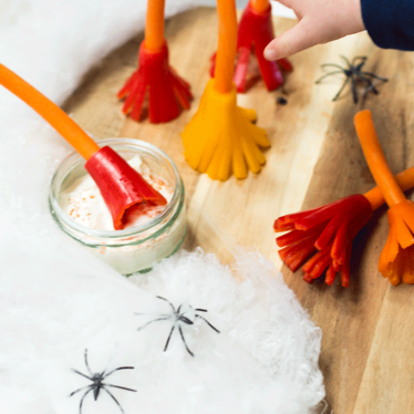 These Witches broomsticks are a perfect healthy halloween snack. Made from carrot and peppers.
