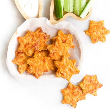 Carrot Stars on a Toddler Plate with Three Scattered Around the Plate