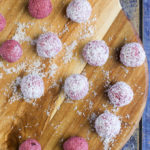 Raspberry Coconut Breakfast balls, sweetened only with fruit. A perfect hand held breakfast for young kids. No refined sugar or sweeteners.