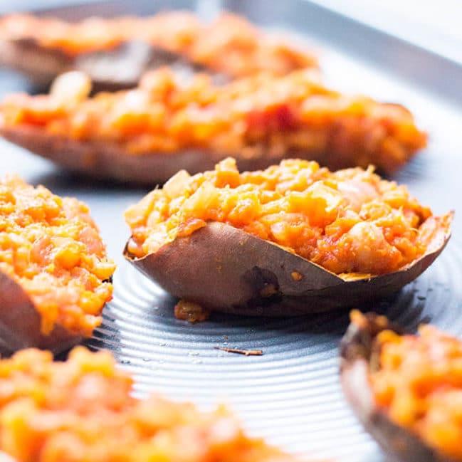 These smokey chickpea loaded sweet potato skins make a perfect, healthy meal. The health benefits of sweet potatoes are boosted with protein from the chick peas and part of your five a day from the onion and tomatoes. Delicious but super healthy. Delicious topped with greek yoghurt.