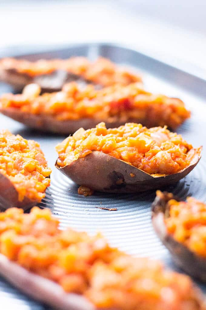 These smoky chickpea loaded sweet potato skins make a perfect, healthy meal. The health benefits of sweet potatoes are boosted with protein from the chick peas and part of your five a day from the onion and tomatoes. Delicious but super healthy. Delicious topped with greek yoghurt.