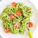 Plate of Avocado Spinach Spaghetti Topped with Cherry Tomato