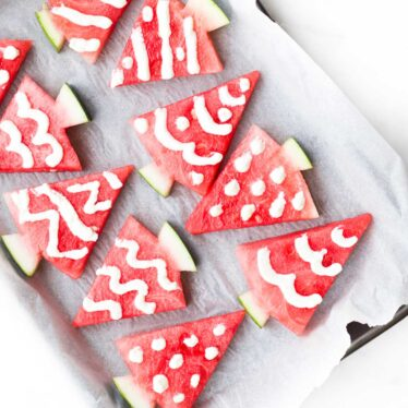 Watermelon Triangles Cut into Christmas Trees and Decorated with Yogurt