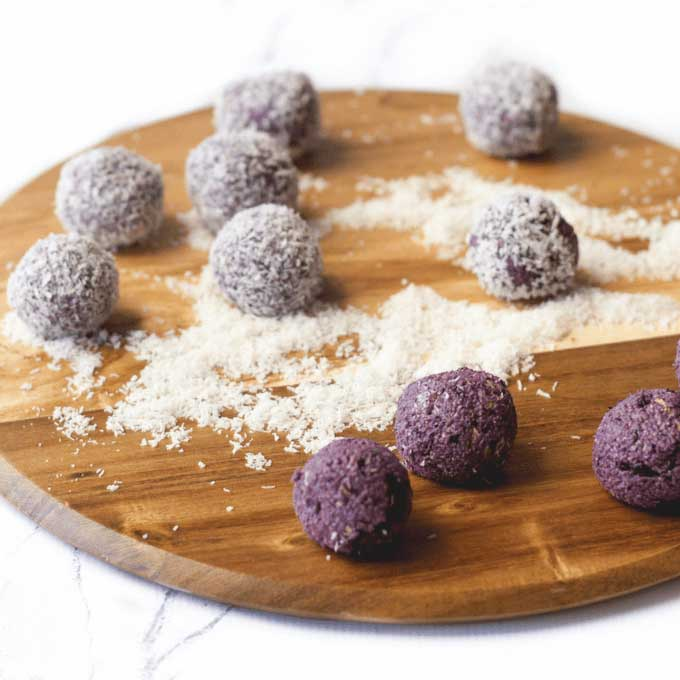 45 Degree Shot of Blueberry Balls on Wooden Board. Some Balls Coated in Coconut and Others Un Coated