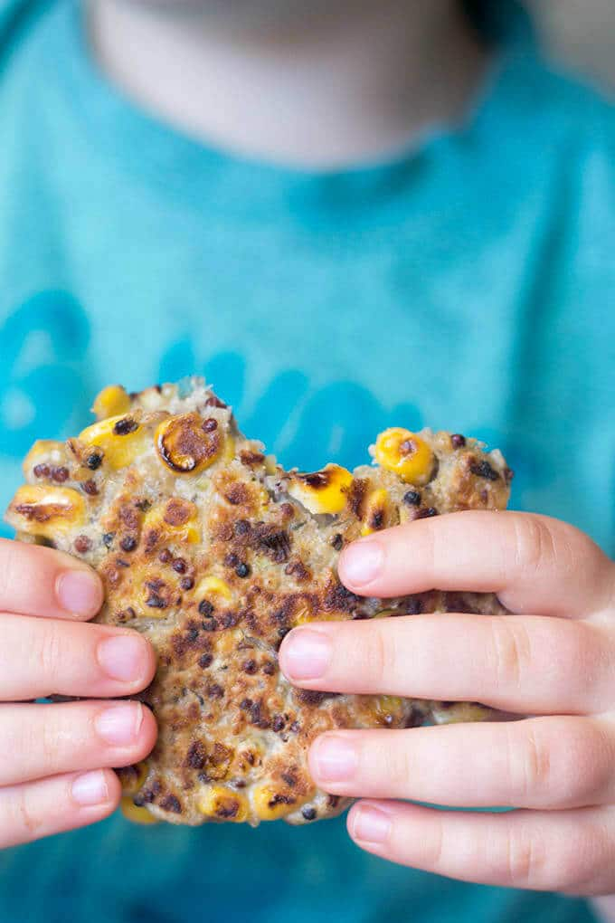 Child Holding Sweetcorn Fritter