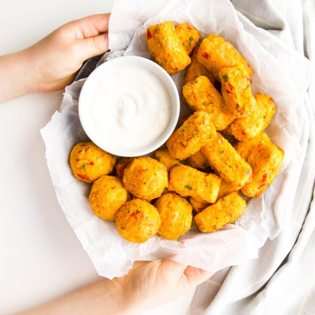 Top Down Shot of Plate of Cauliflower Tots Served with a Yogurt Dip