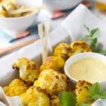 turmeric oven roasted cauliflower bites with a sweet curried mango dip. A kid friendly way to save cauliflower