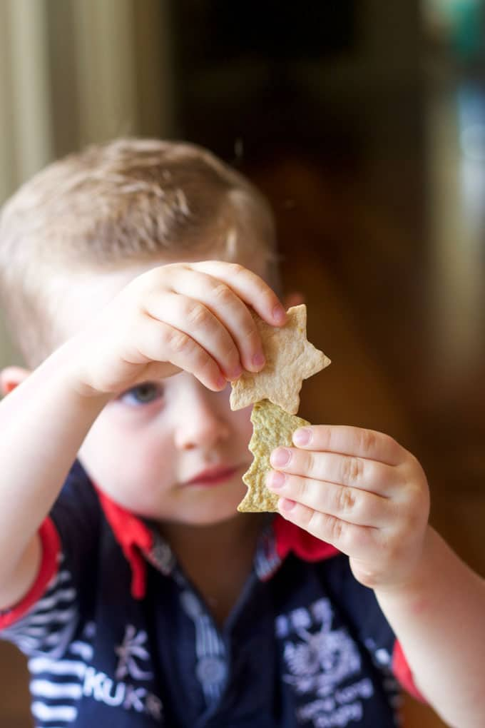 Child Holding Christmas Shaped Tortilla Chips