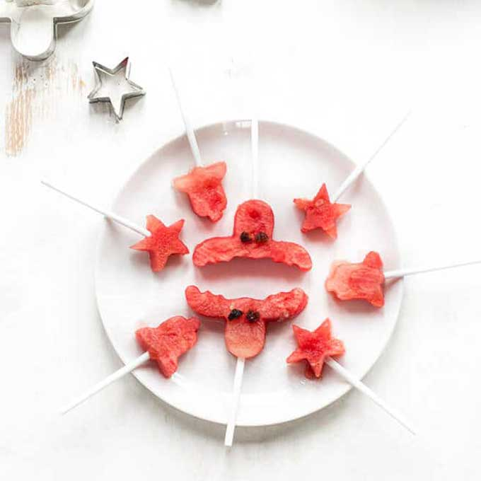 Watermelon Cut into Christmas Shapes and Stuck on a Stick