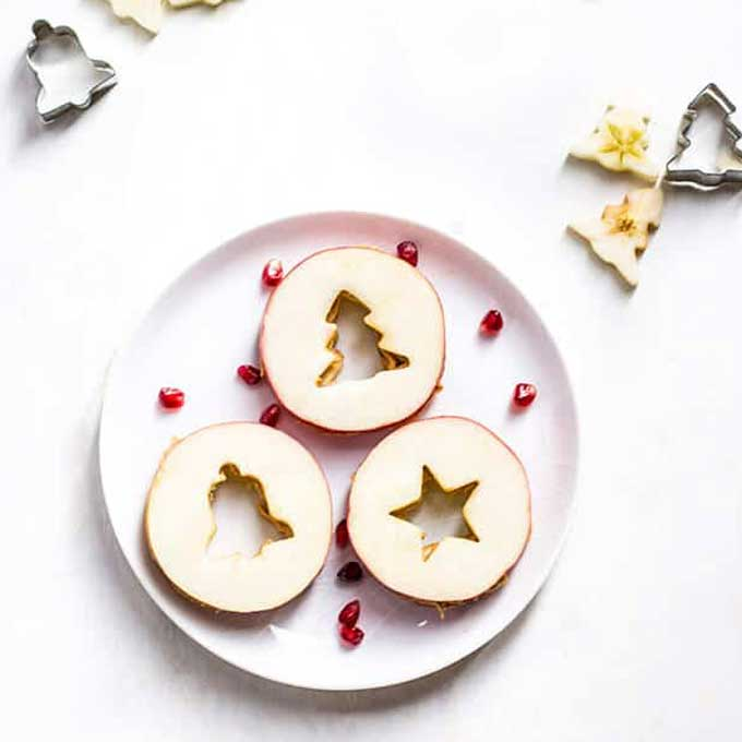 Apple Sandwiches Made with Apple and Peanut Butter with Christmas Shape Cut out Centre