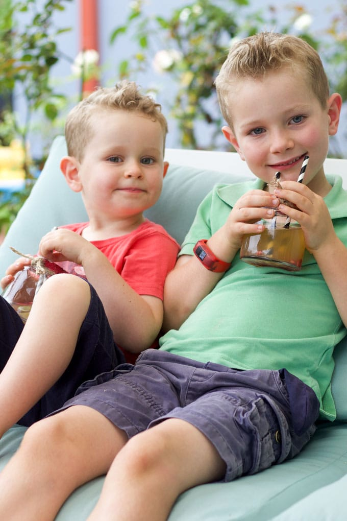 Two young boys drinking cocktails