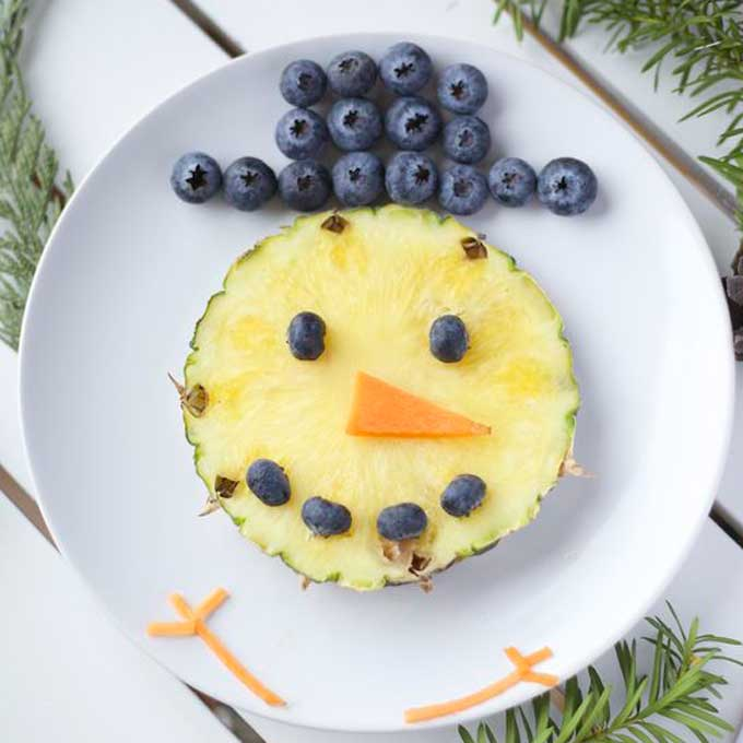 Snowman Made From Pineapple Face and Blueberries Hat