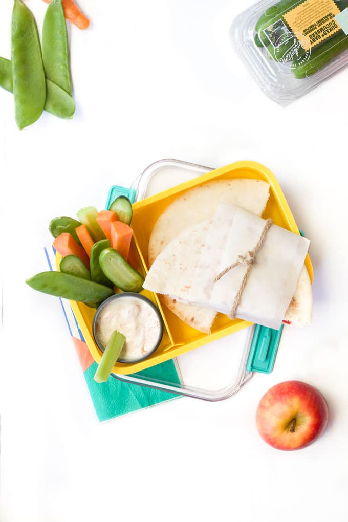Healthy Lunch Box Filled with Sandwich, Vegetables and a Yoghurt Dip