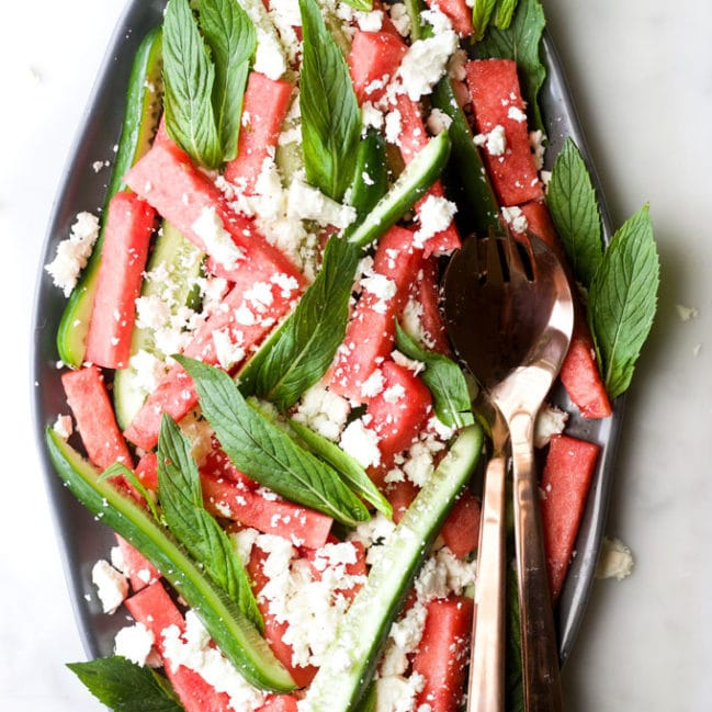 watermelon feta mint salad on serving plate