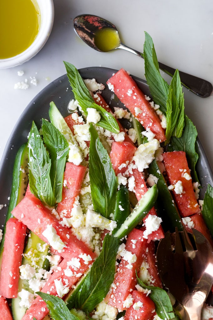 Plate of watermelon feta mint salad with dressing on the side