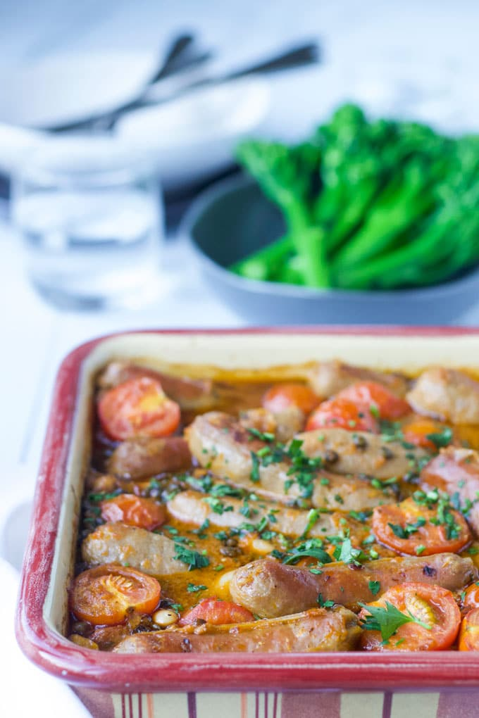 Sausage and Lentil Bake in Baking Dish with Side of Broccolini in Background