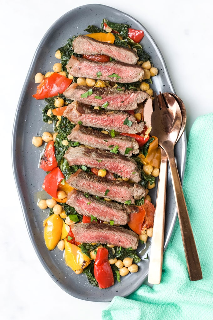 Striploin Steak Served on a Bed of Kale, Pepper and Chickpeas.