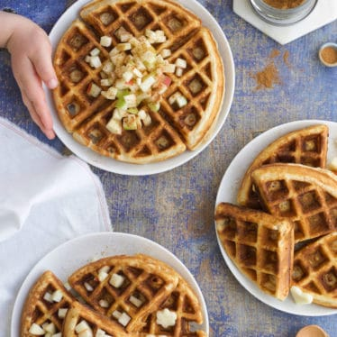Apple Waffle Stacks Topped with Fresh Apple. Child Grabbing Plate