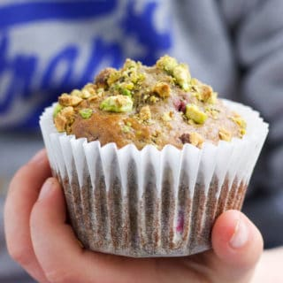 Child Holding a Pistachio and Raspberry Muffin