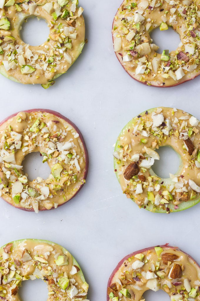 Apple Slices Topped with Peanut Butter and Chopped Nuts