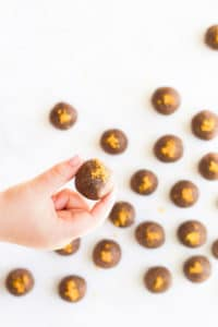 Child Holding Chocolate Orange Energy Balls
