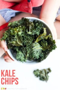 Kale Chips are a great way for getting your kids to love leafy greens. They are light, crispy and melt in the mouth. #kidssnack #snack #kale #kalechips #kidsfood