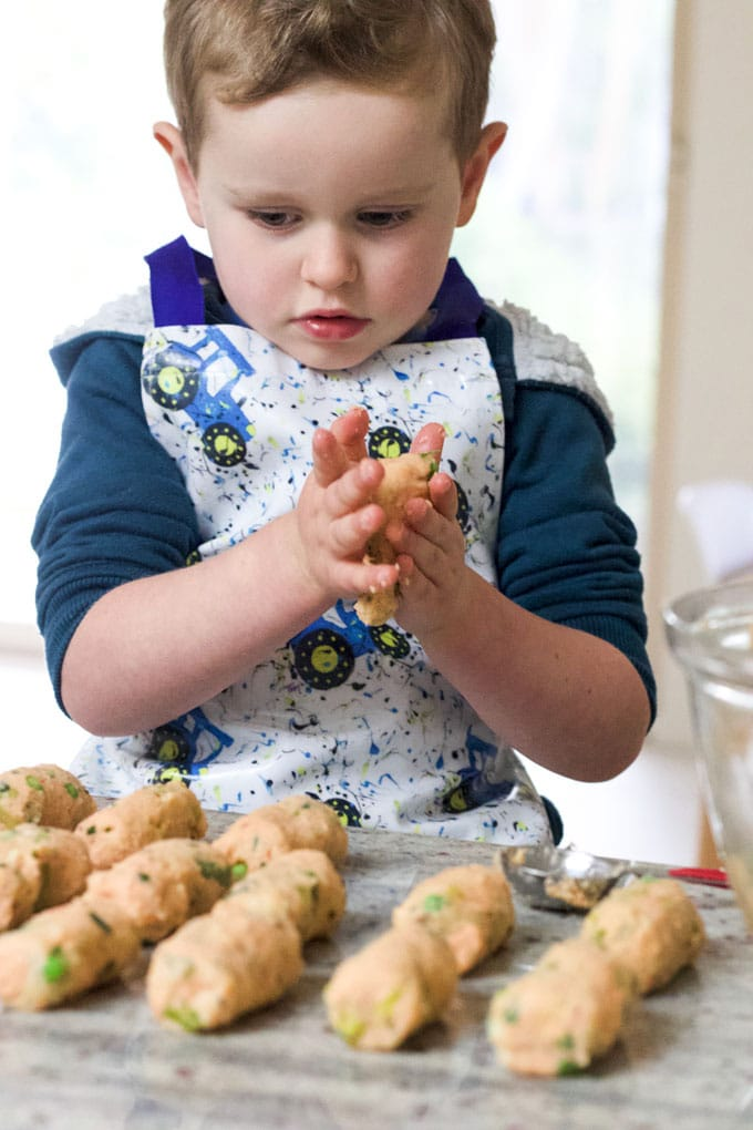 Child Rolling Salmon Croquettes